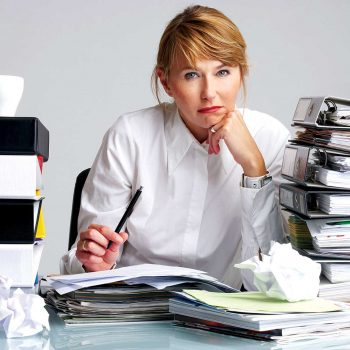 Lady overwhelmed with files and folders